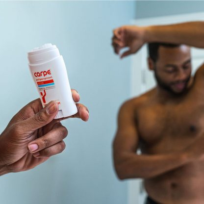 A man using Carpe Underarm Antiperspirant